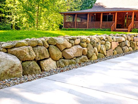 Boulder retaining wall by SereneScapes