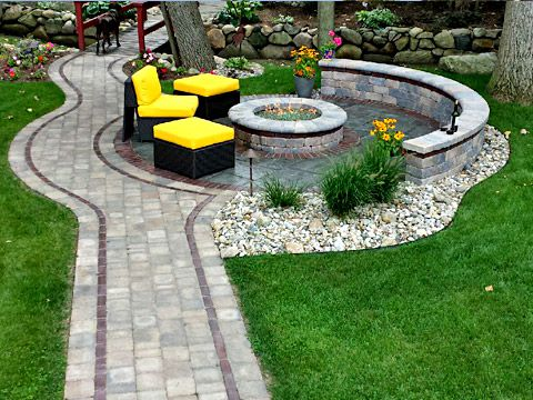 Patio fire pit and walkway designed and constructed by SereneScapes