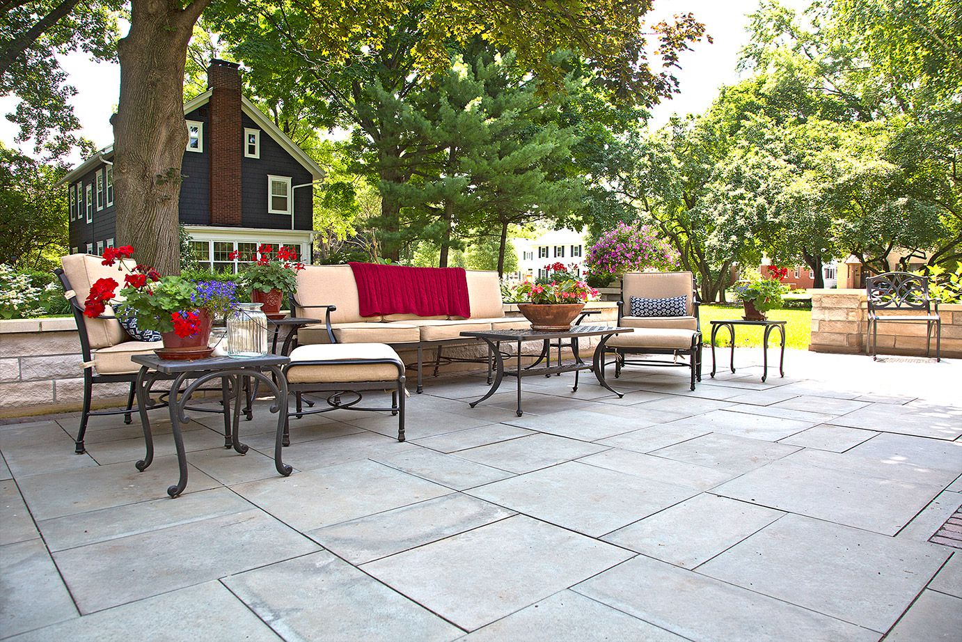 Beautiful stone patio and quality outdoor furniture by SereneScapes